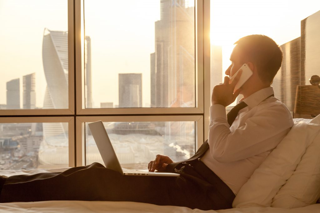 Business traveler in hotel ordering room service - Manet Mobile Solutions